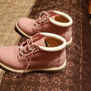 Pink Timberlands  and black leather boots  only wo